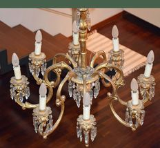 A Venetian chandelier in gilt wood, with cut glass pendants - Italy, late 18th / early 19th century