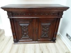 Carved dark wooden low buffet, France