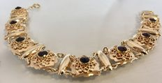 Gold boat bracelet with garnet, finely tooled around the garnets,  which are in perfect condition.