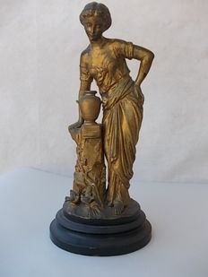 "Old sculpture created with lost wax casting technique on ebonized walnut base - ""woman at the fountain""  France, in gilded antimony, early 1900s"