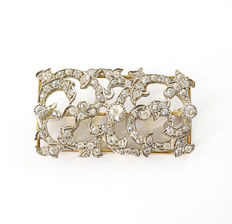 Gold and diamond antique brooch with floral geometric design, ca. 1920