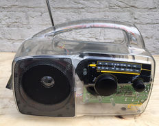 Self-sustaining radio, brand Freeplay, runs on solar energy or on a wind-up generator, a so-called prepper radio