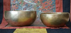 Set of two Tibetan, hand hammered, singing bowls - Tibet / Nepal - second half 20th century.