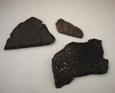 Three slices of meteorites. NWA 11140, H3 - 12,68 g - Chondrite Dimmitt Classification H3.7 Landed in Texas in 1942 of 1.95 g - chondrite meteorites classified L5-6 W3 of 16.93 g