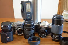 Two Japanese slr cameras, the Yashica FX 103 program and the Mamiya Family. With 2 additional lenses, flash, converter and lens hoods.
