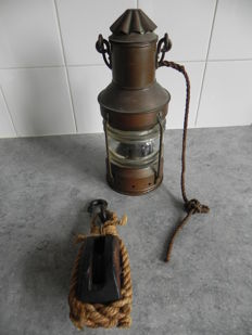 Old ship's lamp with wooden pulley
