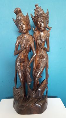 A statue of Rama and Sita carved from wood - Bali - Indonesia