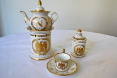 Imperial Manufactory - White and gold porcelain with decoration of the emblems of Napoleon: teapot, covered pot, cup and saucer - XIXth