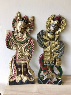 Two large, handmade, wooden wall decorations, dancers - Bali - Indonesia.