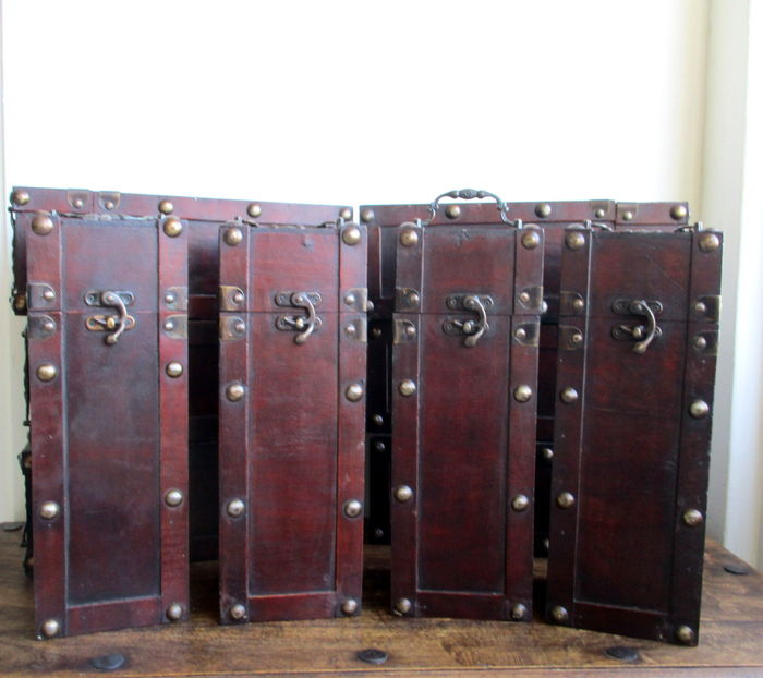 Set of ten wooden wine boxes with brass details