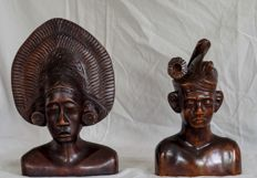 Wooden, carved busts of a man and a woman – Bali – Indonesia