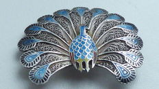 Sterling silver peacock brooch with inlaid enamel in blue, red, yellow and black