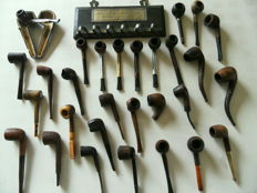 Collection of 29 pipes and pipe rack - 20th century.