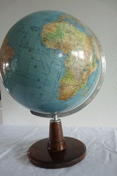 Big old desk globe on a wooden pedestal