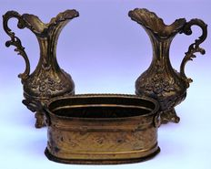A pair of bronze ewers and a planter/jardiniere - Continental - 20th century