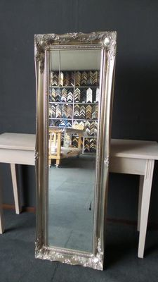 Large Dressing room mirror with faceted glass, hand silver-gilded frame with ornamentation.