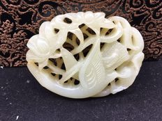 Jade pendant carving of a swan under lotus leaves- China-early 20th century