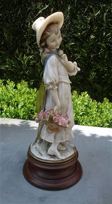 "Capodimonte sculpture ""flower girl"", signed G. Armani"