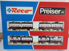 Roco/Preiser H0 - 44008/30725 - set: 4 stake cars loaded with 8 vehicles of circus Krone of the DB