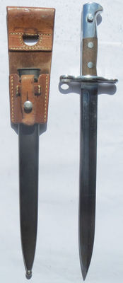 Swiss long model 1918 early bayonet with blood channel, complete with sheath and holder in excellent condition.