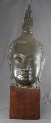 Bronze Buddha head on wooden pedestal - Thailand / South-East Asia - 2nd half 20th century.
