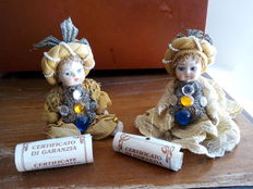 Two hand painted ceramic dolls