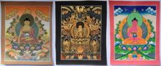 Three Buddha paintings, Tibetan art - Northern India - late 20th, early 21st century.