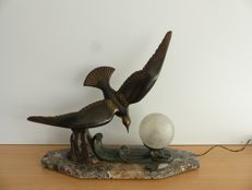 Art Deco table lamp with a bird on a marble base