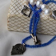 Set: a heart-shaped Sterling Silver pendant, Freshwater pearl bracelet (9.5mm), a necklace with a old silver Celtic designed pendant with slot and Lapis Lazuli color beads.