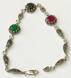 925 sterling silver bracelet composed of one emerald gemstone, one sapphire gemstone, one ruby gemstone and 14 marcasite gemstones.  Bracelet length: 19 cm.