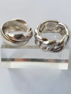 Two unique solid silver rings - weight: 36.5 grams - size: 17.75 mm and 17 mm - in very good condition.