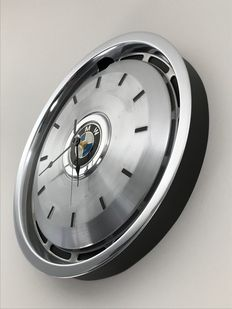BMW - Black wall clock on a hubcap from the 80s