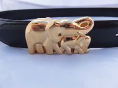 "An exclusive ""Cartier"" Authentic  ""Mother and Baby"" Elephant Gold Buckle Leather Belt with gold plated buckle . Paris France round 1990,"