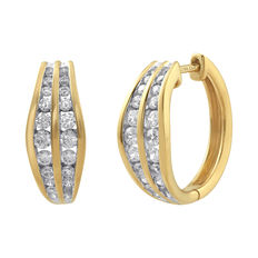 Brand new 18kt yellow gold diamond hoop earrings set in a shaped channel setting, 0.75ct total weight. G colour and SI clarity. Secure clip fastenings