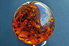 Polished synthetic Amber sphere - 9.8cm - 592gm