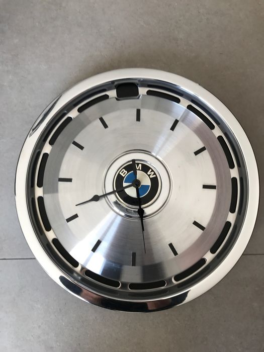 BMW - Black wall clock on a stainless steel hubcap from the 80s