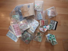GDR - Loose stamps, stamps on piece, blocks, official stamps, accumulation in envelopes, blocks, corner, and edge pieces
