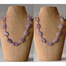 Lot of two necklaces with large pieces of amethyst and ametrine
