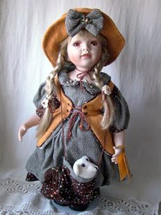 Collectable porcelain doll with a teddy bear in the bag - RF - Germany