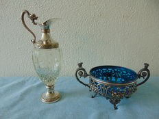 A Jardiniere of silver-tin and a carafe distillerie