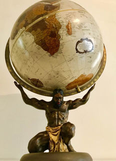 Bronze Replogle globe with Zeus supporting the Earth.