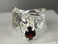 Silver designer ring with garnet drop from the 70s.