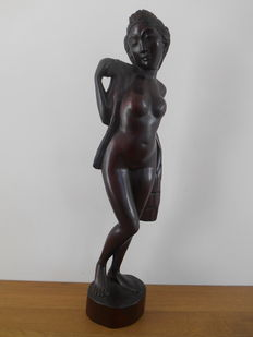 Statue of a young lady made of Java rosewood