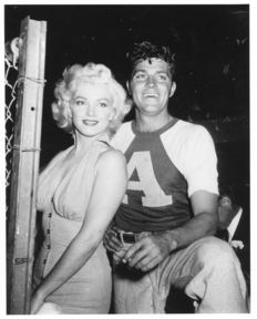 Hulton Archive/ Getty Images/ Globe Photos - Marilyn Monroe & Dale Robertson - Gilmore Field Stadium - Los Angeles - 1952