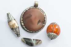 4 pendants from the Himalaya regio - 2nd half 20th century