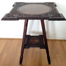 Beautifully carved ironwood side table, with with elaborately detailed top, Indonesia