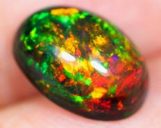 Rainbow Multi-color Play Solid Smoked Opal- 10.7 x 7.4 x 5mm -1.98ct