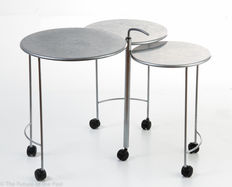 Designer unknown – 3 round metal side tables on 7 wheels