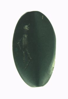 Amulet seal with naked human figure, olive green gemstone, h = 28.8mm