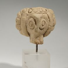 Terracotta head of Syrian idol H. 3 cm